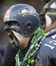 Amusing_Wacky_Dressed_Up_Seattle_Seahawks_Football_Team_Fan-1-180x215
