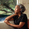 17071-an-african-american-woman-looking-out-a-window-pv
